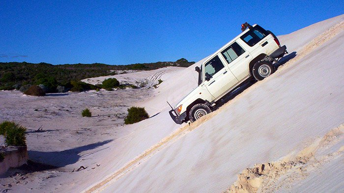 Learn and practice how to perform steep sand hill descents in a four-wheel drive in Perth.